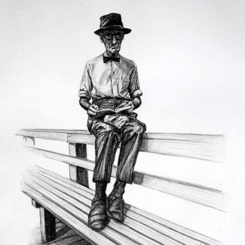 Mann auf Bank